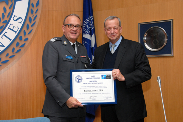 "General Allen receives the award of NDC ""Honorary Ancien"" from MGen Bojarski."