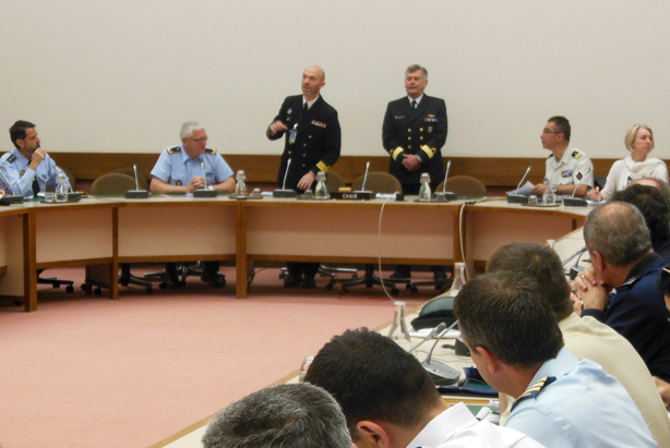 Cdr Jose Henriques (left) and Cdre Hans Helseth welcome SC 126 to NATO HQ.