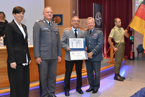 Senior Course 126 President BGen. Reinhard Kloss (DEU A), receives his graduation diploma from IMS Director Sir Christopher Harper, NDC Commandant MajGen Janusz Bojarski and Dean Dr Daria Daniels Skodnik.