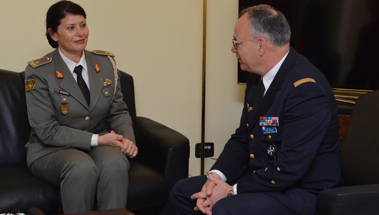 The Commander of the Albanian Training and Doctrine Command Brigadier General Manushaqe Shehu (l) converses with the Head of the NDC Academic Operations Division Major General Pascal Valentin.