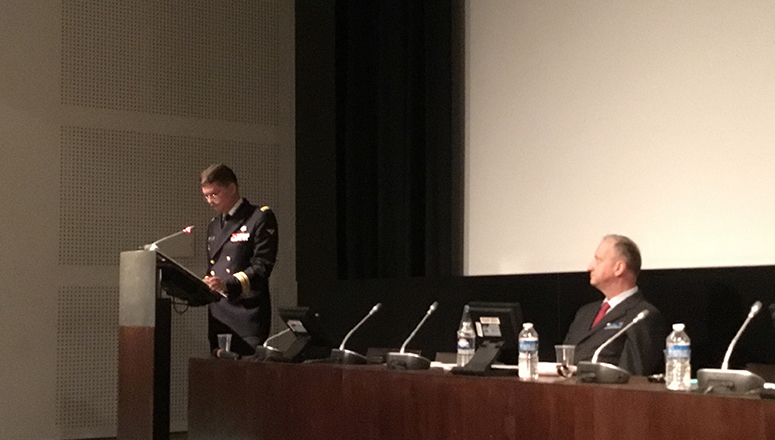 Navy Captain Xavier Moreau on the left, during his presentation, with Navy Captain Gelly moderating