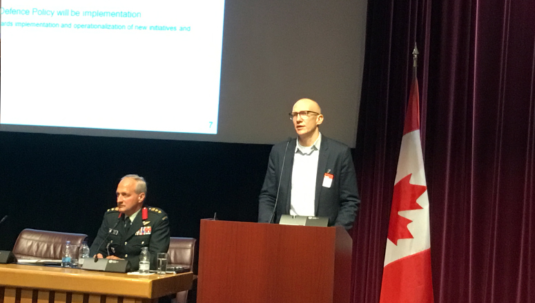 Mr Jonathan Quinn during his presentation about the Defence Policy Review. On the left, Col Ian Hope from the NDC, moderator of the day.