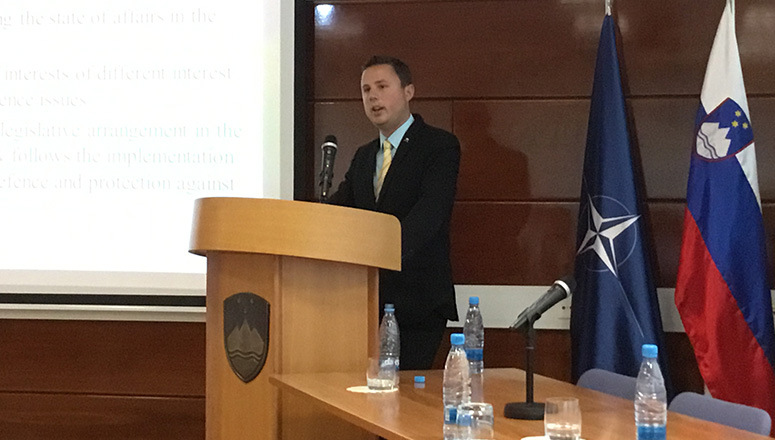 Mr Žan Mahnič, Head of the Parliamentary Committee on Defence, during his presentation