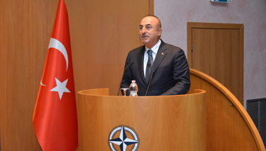 Minister Çavuşoğlu addresses distinguished members of the Diplomatic corps, Senior Course 131, NDC faculty and staff.