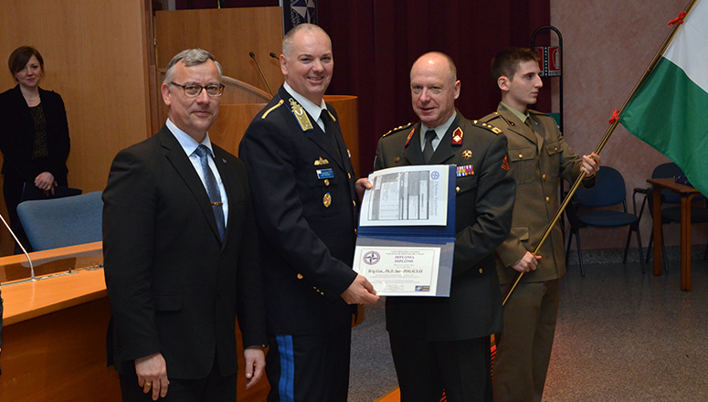 SC 129 Course President, BrigGen Dr Imre Pogàcsàs (HUN F), receives his graduation diploma from LtGen Broeks and BrigGen (ret.) Mičánek.
