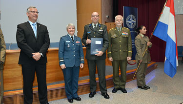 SC 131 Course President, Colonel Robert Van Zanten, (NLD A), receives his diploma